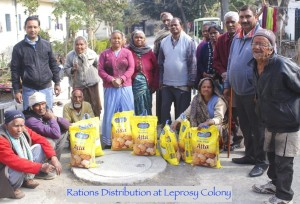 A group of physically challenged Indian Leprosy patients with dry food rations in large bags